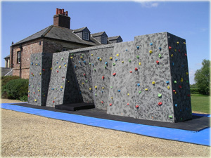 Mobile bouldering wall or traversing wall for fun days and sporting events including rock climbing experiences
