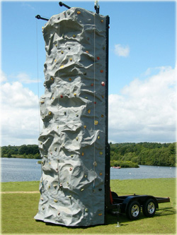 Rock Climbing tower on a portable trailer for hire at events in Kent, Sussex, Surrey, Suffolk, Sussex, Hampshire, Hertfordshire, Essex, London and throughout the south east