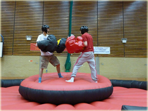 Inflatable bouncy boxing ring can be used as an inflatable activity at your extreme event and sporting activity days.