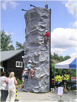 Mobile rock climbing tower for hire at Fun Days and other sporting activity days